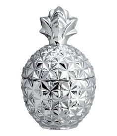 Pineapple-shaped glass jar with a silver-colored finish and a lid.