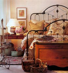 Black iron bed frame and a basket collection make this bedroom interesting.