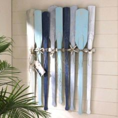 Use oars to decorate your exterior walls: 27 Awesome Beach-Style Outdoor Living Ideas for Your Porch and Yard