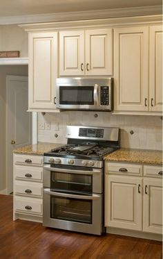 Restored Kitchen Cabinets - Home and Garden Design Ideas. I love white cabinets but now BAM WHITE but off white with a worn look!