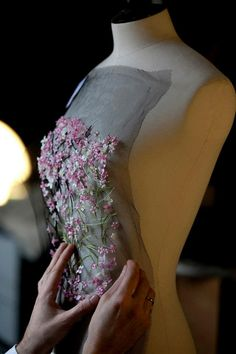 Dior  The creating of the Spring 2013 couture collection.