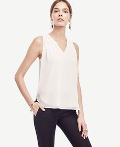 In airy light chiffon, this shirred style flatters with a smart shirttail hem…