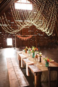 Rustic wood wedding reception with twinkle ceiling lights; Featured Photographer: Lisa Wise Photography