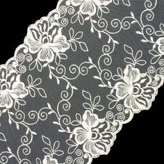 Our beautiful Embroidery Lace makes fashionable accent to your evening and lingerie garments. The embroidered sheer lace features a symmetrical floral design decorating the borders of the lace. This lace is non-stretchable and looks great on various garments such as wedding gowns or veils. Embellish dresses, shirts, intimate lingerie. The wide lace is available in one style.