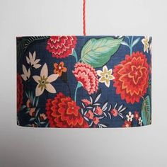 Our gorgeous Nasturtium linen lampshade features a bright and beautiful colour palette of flowers and leaves.Available as a pendant shade to hang from the ceiling or to fit a floor or table lamp.This large colourful table or floor lampshade features our furnishing fabric Carnation, designed exclusively for Winter's Moon by designer Brie Harrison. The gorgeous colour palette is bright and beautiful on a dark inky background and is printed in the UK onto linen. The shade is then made by hand…