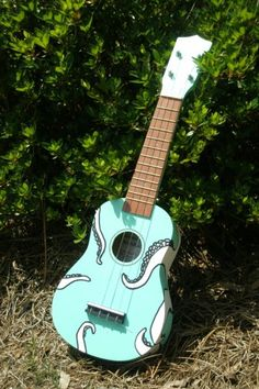 Do It Yourself Ukelele made from a kit.  It has an octopus on the back with legs that reach all over the ukelele.