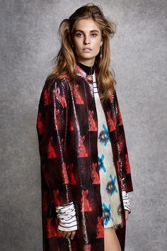 Layer bold prints for optimal effect.  Prada coat, $14,330, dress, $5,660, sweater, $980, and earrings, $370, prada.com.   - HarpersBAZAAR.com