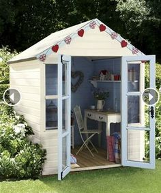 In Need Of Shed Color Ideas? British bunting on a garden shed. A beautiful shabby chic garden shed.