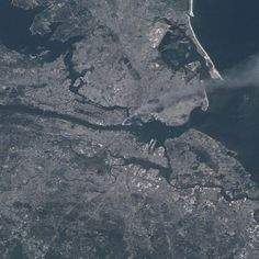 NASA Remembers September 11, 2001: Visible from space, a smoke plume rises from the Manhattan area after two planes crashed into the towers of the World Trade Center. This photo was taken of metropolitan New York City (and other parts of New York as well as New Jersey) the morning of September 11, 2001.