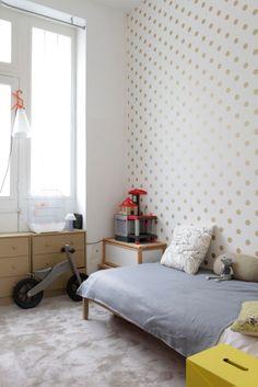 Calming grey and gold kids room. Great polka dot wall. | via rackcdn.com