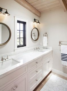 """Place fixtures wisely. When choosing fixtures for a bathroom, Sneed prefers four-inch recessed can lights overhead, which have a clean look. """"For functionality, you really must have an overhead light,"""" she says. The designer pairs an overhead fixture with sconces alongside or above the mirror to make the reflection more flattering. """"It's important that there is some light between your face and the mirror,"""" she says. """"If you're just backlit, you wind up with your face in shadow."""""""