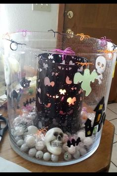 Using the Spooky Eyes Hurricane inside our Majestic and adding some scary spiders and clings - create this look.  www.partylite.biz/DayswithDeanna