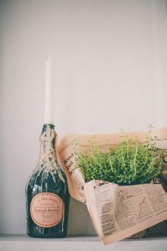 love the simple newspaper and candle in bottle