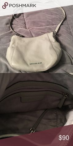 Crossbody Real Michael Kors gray crossbody. Good condition, and fits a good amount in it.Throw a offer out and I can negotiate. Michael Kors Bags Crossbody Bags
