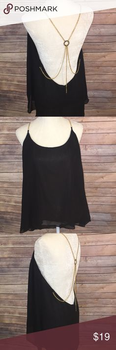 Victoria's Secret hi-lo sheer black blouse Black sheer, lined hi-lo blouse with gold tone chain straps. Sexiest top, perfect for New Year's Eve. Victoria's Secret Tops Blouses