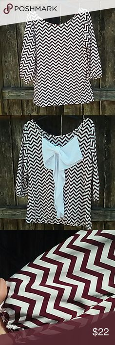 Chevron Blouse with Bow Crimson and white Chevron print blouse with bow on back. Super cute top. This is a reposh that didnt fit   great condition no flaws...rips, stains ect. Tops Blouses
