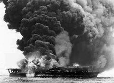 The Japanese aircraft carrier Kaga in flames during the Battle of Midway, June 4, 1942. It is more than likely to be a tricked image of propaganda.