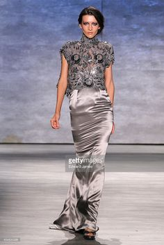 Katya Tolstova walks the runway at Venexiana during Mercedes-Benz Fashion Week Spring 2015 at The Pavilion at Lincoln Center on September 6, 2014 in New York City.