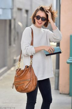 Jumper for joy: The day before, she was pictured walking around in yet another cute ensemb...