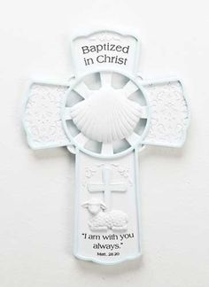 The Milestone Baptism Wall Cross for Girl was created to celebrate the sacrament of Baptism. The cross has delicate scrollwork and displays a simple white shell, symbol of water being poured during Baptism. This cross makes a great Baptismal gift. Baptism Gifts For Boys, Baby Baptism, Baptism Dress, Getting Baptized, The Cross Of Christ, Wall Crosses, First Holy Communion, Christian Gifts, Crucifix