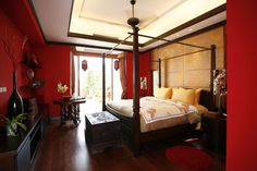 I want this bedroom and the four poster bed with red walls included!