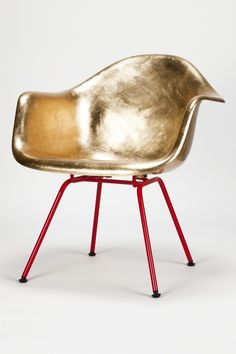 Eames Golden A Shell, gold leaf, fiberglass, lacquered metal, Designer Charles & Ray Eames/Reha Okay,Manufacturer Hermann Miller/okay art. Owner of Basel-based vintage furniture gallery okay art, Reha Okay offers a limited production of vintage Eames and Jacobsen iconic chairs with a beautiful red base and shinny gold seating. Each piece is hand-gilded then varnished, several times polished and base-lacquered by a car painter.