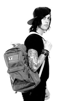 Kellin Quinn modeling a bookbag (which I need) from his clothing line, Anthem Made.
