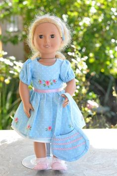 Let's go to a birthday party or afternoon tea!  This is the perfect short sleeved dress in a delightful light blue polka dot fabric with