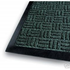 "Gatekeeper Indoor Entrance Mat by WMU. $515.76. Indoor Entrance Mat 100% polypropylene tufted carpet with a raised rubber border. Gripper backing minimizes movement. Rubber reinforced parquet pattern is functional in both directions and provides a crush-proof scraping surface. Heavyweight carpet holds up to 1 1/2 gallon of water per square yard. Standard sizes are nominal NOT actual. Tolerances: +/- 3% on standard sizes. Actual Sizes: 4'x10' (44.5""x117"") Colors ..."