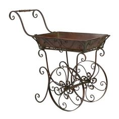Flower Cart Plant Stand | Kirklands-------I've been wanting one of these as long as I can remember.  There are many styles - and I like them all!  LOL