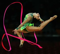 Mariam Chamilova of Canada performs with the ribbon as she competes in the in the All-Around Rhythmic Gymnastics Final