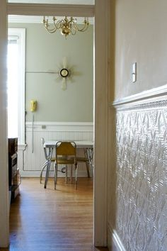 Love the wainscoting + color & tin ceiling tile on wall. This would be perfect in the kitchen on the blank wall. Go above the mop board, and then put a finish on the top. Could do this in the living room too. And to stenciling on the top of the wall. Tin Tile Backsplash, Kitchen Wall Tiles, Bathroom Wall, Small Bathroom, Attic Bathroom, Bathroom Ideas, Wainscoting Styles, Wainscoting Hallway, Wainscoting Height