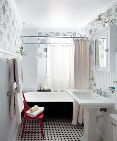 Tub with shower fixtures, beadboard on walls