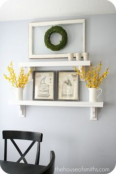Shelley of The House of Smiths is amazing.   Her decor style is always clean and beautiful.  I love this wall display.  Something similar will make it's way into our home.