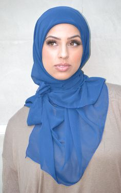 Hijab style that covers. Can't tell if square or rectangle scarf