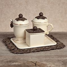 Add old world elegance to your afternoon tea or after-dinner coffee with this three-piece cream and sugar set from the GG Collection.  The set includes a sugar bowl with spoon, covered creamer, packag...