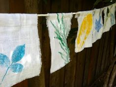 Leaf-Print garden flags - using rollers to put the paint on the leaves and to transfer it to linen