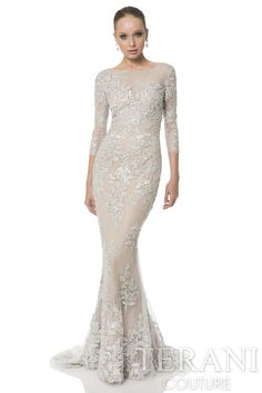 Beaded flower motifs embellish a lace evening gown with three-quarter sleeves. An elegant trumpet skirt finishes this formal gown.