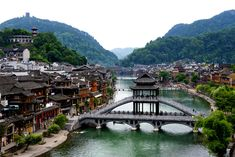 This picture taken of the ancient town of Fenghuang. reveals the stunning homes and bridges. Much of Fenghuang dates back hundreds of years and boasts stunning Qing and Ming-dynasty era architecture. In China, Shanghai, China Architecture, Peking, Zhangjiajie, Hongkong, House On Stilts, Religion, River Bank