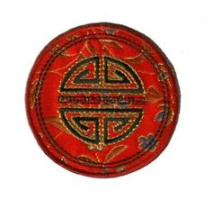 "In Chinese culture, the color Red symbolizes good fortune and ultimate joy. It serves here as the perfect backdrop for the Chinese symbol for longevity in this satin round Prosperity applique Embroidered in the center is the Chinese symbol for longevity in contrasting black with metallic gold thread outline. Black thread detail runs down the middle. Remarkably versatile, this applique would look great on sofa pillows, handbags, jackets, jeans pockets, drapes and more! Measures 2-1/4""…"