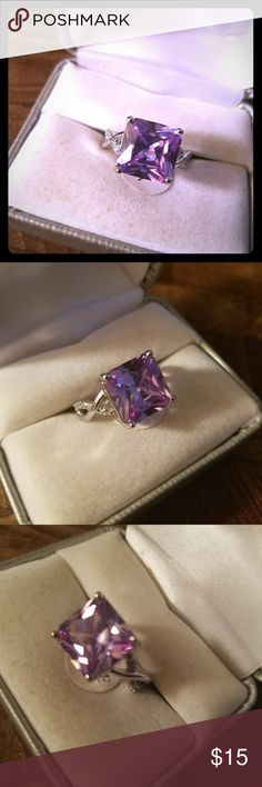 Size 7 Sterling Silver Amethyst Ring Please let me know what size you need. If I have it, I'll make you a separate post.    Sterling Silver stamped. Gorgeous 4 ct. Princess cut Amethyst ring. This one is a size 7.  Feel free to buy it.  Feburary birthstone.    New, never worn.  Box in picture is for display purposes only.  Smoke free.  Free gift with purchase. Don't forget to bundle together to save an 15% and to save on shipping too. =) Thank you kindly. Jewelry Rings