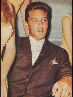 Elvis in Weeki Wachee Springs, FL, July 30, 1961, being photographed with the mermaids.