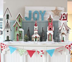 The Happy Housie - our Christmas Mantel with giant village houses, and DIY simple fabric bunting - for Christmas Party Tour of Homes
