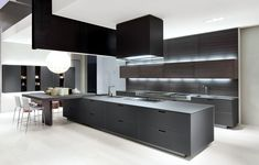 Double depth island, floating cabinets, separate seating at peninsula