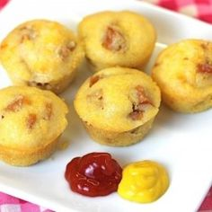 Baked Corn Dogs - used a pack of Jiffy, added 4-5 sliced up hot dogs & baked according to package. Healthier option to fried. CORN DOGSSSSS! - Childhood fav now for an adult!