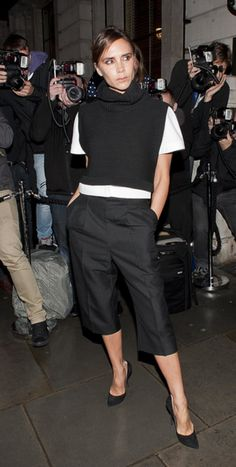 London-Bound! Celebrities Take Their Seats in the Front Row: Victoria Beckham accented her cropped black pants with a white tee, which she layered under a black cowl neck sweater at the British Vogue party.