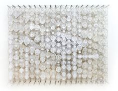 Hashimoto frequently uses acrylic, paper, bamboo, and nylon to create densely layered installations of translucent discs and other geometric shapes that are mounted on walls