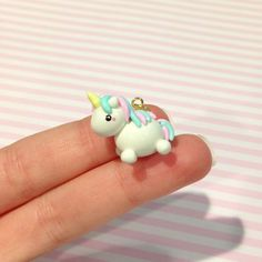 This listing is for a pastel unicorn charm. This charm is handmade by me using polymer clay. A jump ring is included so you can put it on a