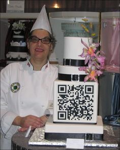 Here comes the code: Wedding cake design complete with large QR code.