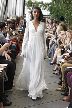 A relaxed bohemian look with a deep V-neckline and billowy sleeves from Delphine Manivet {Photo: Dan Lecca}